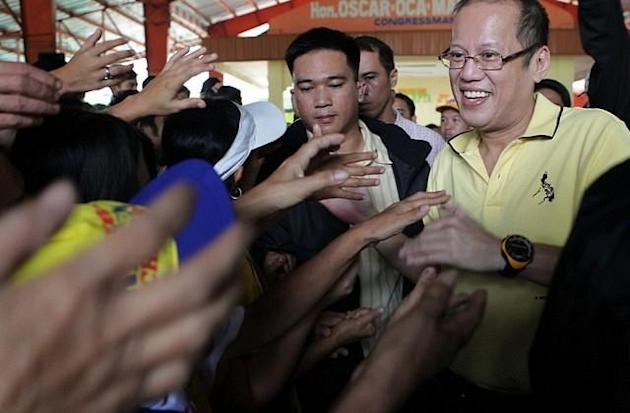 File photo: President Benigno Simeon Aquino lll leads the distribution of family food packs to flood-affected residents at the General Tiburcio De Leon Elementary School in Valenzuela, the President said that he had directed the Department of Public Works and Highways and all concerned agencies to formulate a sure fire solution that will address the flooding problem in the city. (Gil Nartea, MPB, NPPA Images)