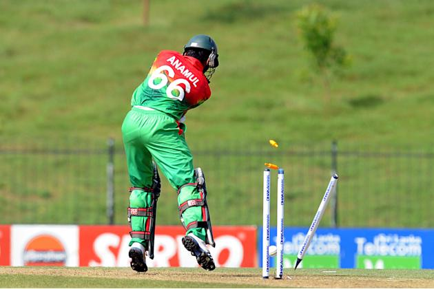 Bangladeshi cricketer Anamul Haque is clean bowled by Sri Lankan cricketer Thisara Perera during the opening one-day international (ODI) match between Sri Lanka and Bangladesh at The Suriyawewa Mahind