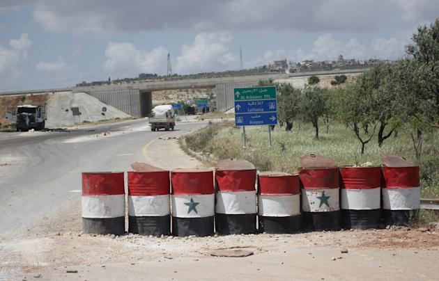 A view shows a checkpoint used by forces loyal to Assad in the northwestern city of Ariha
