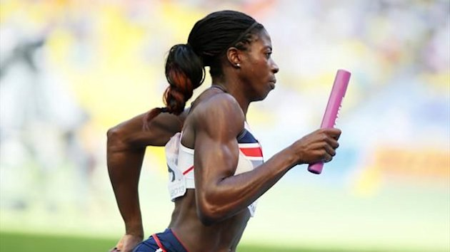 Christine Ohuruogu of team Britain and Northern Ireland runs with the baton in her women's 4x400 metres relay heats during the IAAF World Athletics Championships at the Luzhniki stadium in Moscow August 16, 2013 (Reuters)