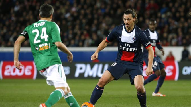 Paris St Germain's Zlatan Ibrahimovic challenges St Etienne's Loic Perrin during their French Ligue 1 soccer match at the Parc des Princes Stadium in Paris