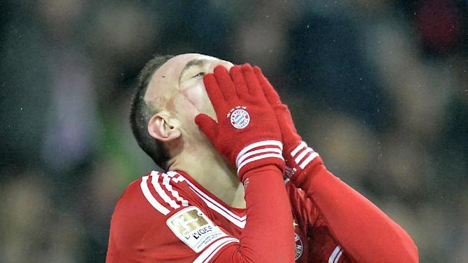 Bayern's   scorer Franck Ribery of France smiles  behind gloves during the German Bundesliga soccer match between Werder Bremen and Bayern Munich in Bremen, Germany, Saturday, Dec. 7, 2013. Bayern defeated Bremen by7-0