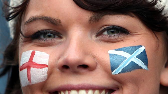 A rugby fan displays her face painted with the flags of Scotland and England ahead of the Six Nations rugby union international match between Scotland and England at Murrayfield, Edinburgh, Scotland, Saturday Feb. 8, 2014. (AP Photo/Scott Heppell)