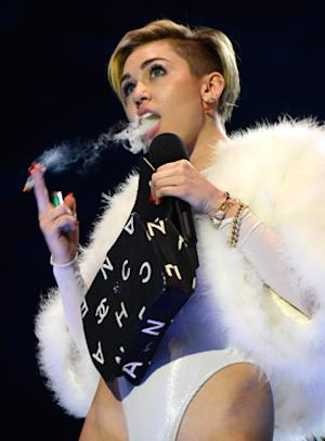 Miley Cyrus Lights 'Joint,' Twerks With Dwarf at MTV EMAs