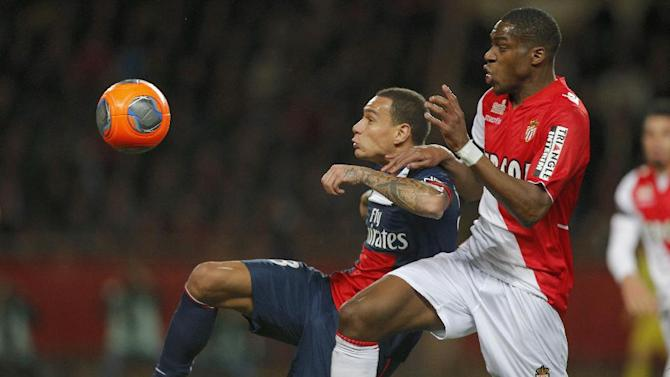 Paris Saint Germain'sGregory Van der Wiel of Netherlands challenges for the ball with Monaco's Geoffrey Kondogbia  of France during their French League One soccer match, in Monaco stadium, Sunday, Feb. 9 , 2014