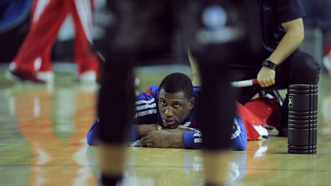 Philadelphia's 76ers Thaddeus Young, warms up before the match  against Bilbao Basket, during the NBA Global basketball game, in Bilbao northern Spain on Sunday, Oct. 6, 2013
