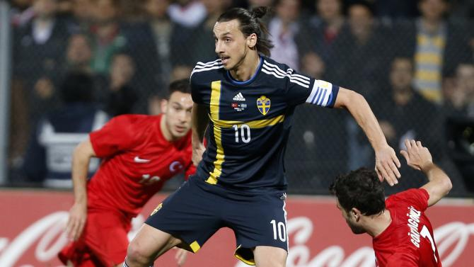 Sweden's Zlatan Ibrahimovic fights for the ball with Turkey's Gokhan Gonul during their international friendly soccer match at 19 Mayis Stadium in Ankara