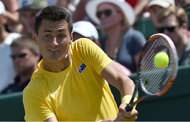 Bernard Tomic of Australia plays a shot during the men's reverse singles match at the World Group first round Davis Cup tennis tournament in Melbourne on March 6, 2016