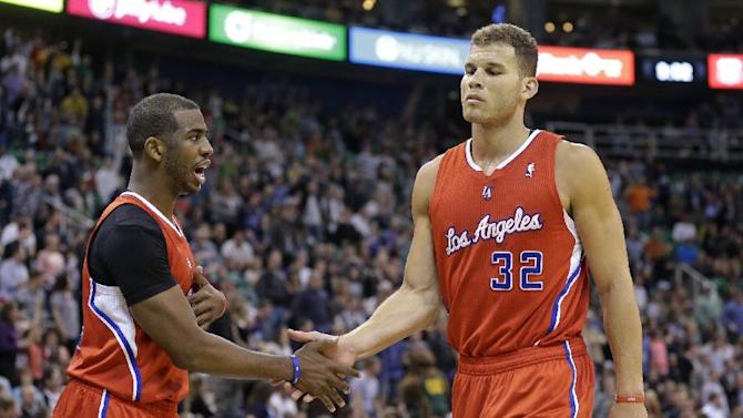Los Angeles Clippers' Chris Paul, left, congratulates teammate Blake Griffin (32) in the second half during an NBA basketball game against the Utah Jazz, Friday, March 14, 2014, in Salt Lake City. The Clippers won 96-87