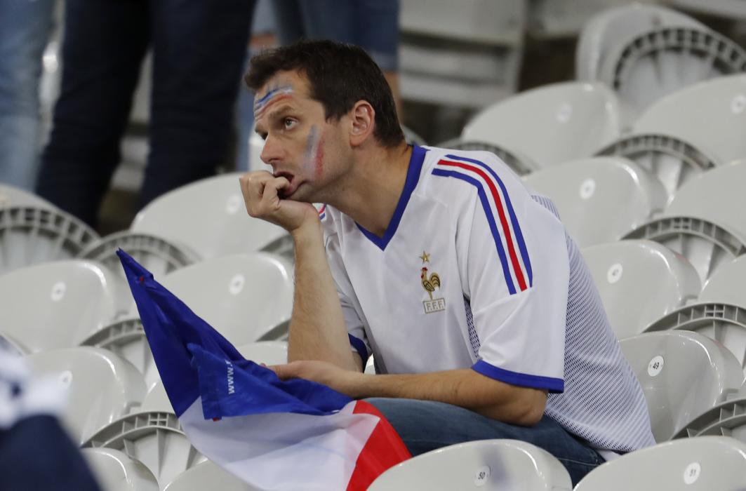 France fan looks dejected at the end of the match