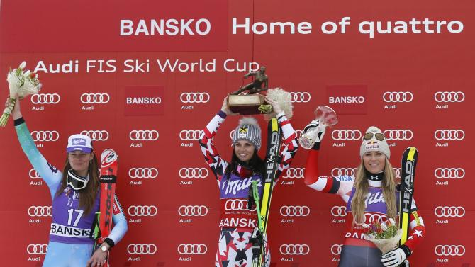 First placed Fenninger of Austria, second placed Maze of Slovenia and third placed Vonn of the U.S. celebrate on podium after the women's Super G event of the Alpine Skiing World Cup in Bansko