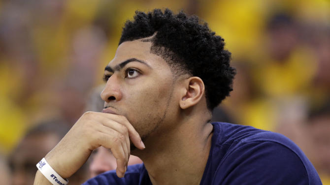 New Orleans Pelicans' Anthony Davis watches from the bench during the second half in Game 1 of the NBA basketball playoffs against the Golden State Warriors Saturday, April 18, 2015, in Oakland, Calif. Golden State won 106-99. (AP Photo/Marcio Jose Sanchez)