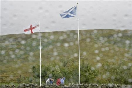 Scottish and English flags flutter in the wind and rain at the border between England and Scotland at Carter Bar September 6, 2013. REUTERS/Toby Melville