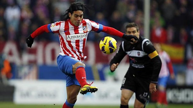 Atletico's Madrid Radamel Falcao (L) controls the ball in front of Levante's Sergio Ballesteros