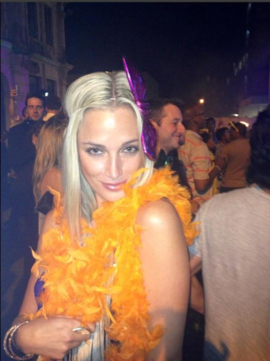 Reeva is dressed bright orange feathers in a photo posted on Twitter. She was born in Cape Town and moved to Johannesburg to pursue modelling (Twitter: Reeva Steenkamp)
