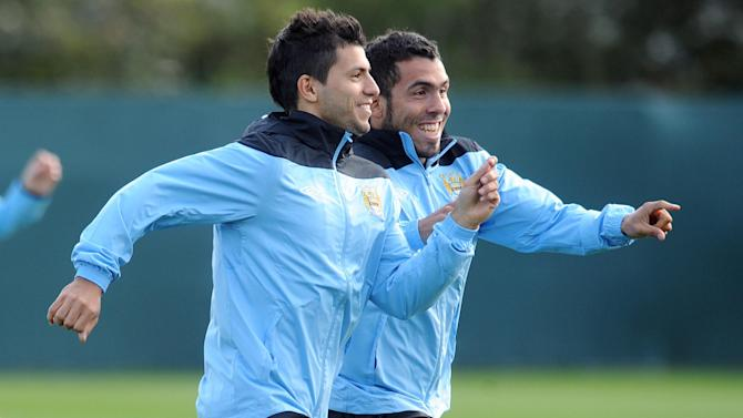 Sergio Aguero and Carlos Tevez (right)