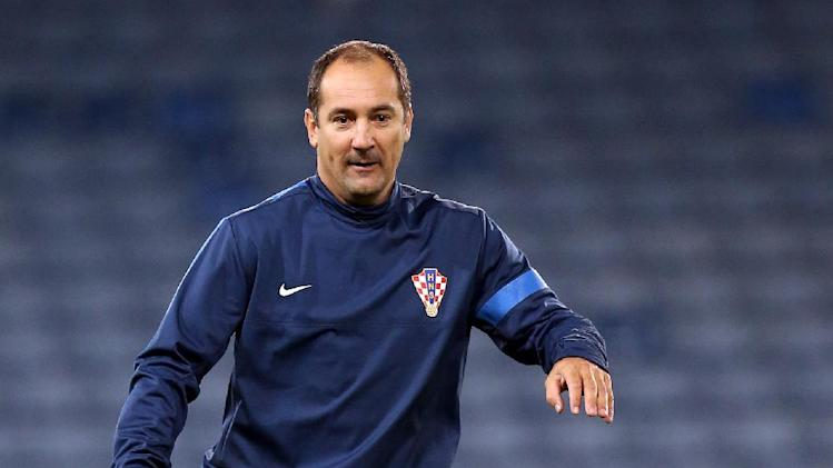 Croatia's manager Igor Stimac controls the ball during a team training session at Hampden Park, Glasgow, Scotland, Monday Oct. 14, 2013. Croatia face Scotland in a World Cup qualifying Group A  soccer match on Tuesday