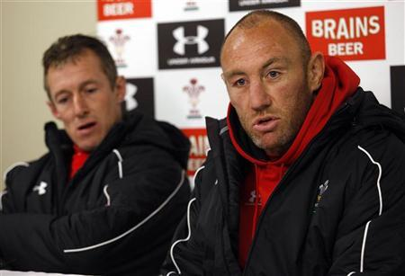 Wales' assistant coaches Howley and McBryde talk to the media after their captain's run in preparation for their international rugby union test match against New Zealand's All Blacks in Dunedin