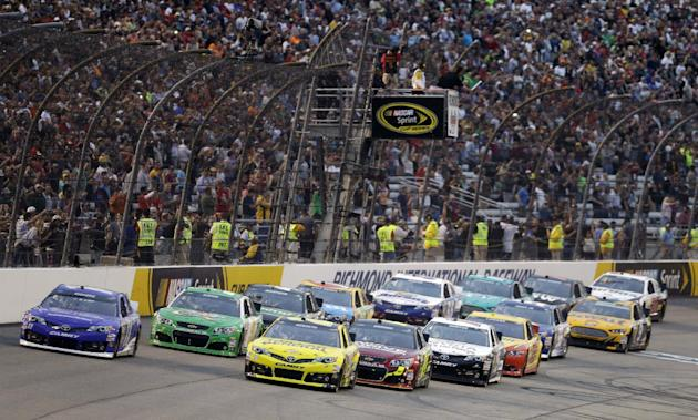 In this April 27, 2013, file photo, Matt Kenseth, front right, leads the field at the start of the NASCAR Sprint Cup auto race at Richmond International Raceway in Richmond, Va. From 2-4:30 p.m. on Sa