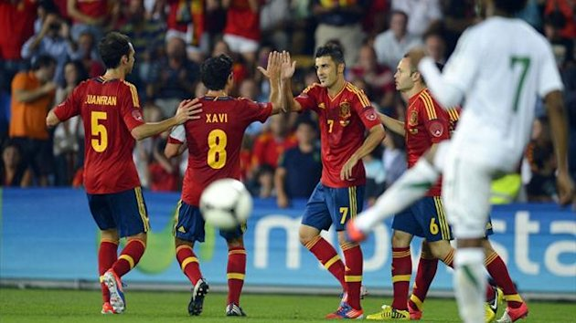 Spain's David Villa (2nd R) celebrates with teammates Juanfran Torres (L) and Xavi Hernandez (2nd L) after scoring against Saudi Arabia (Reuters)