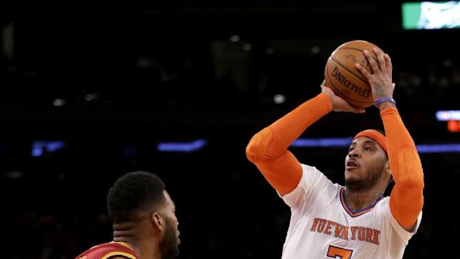 New York Knicks' Carmelo Anthony, right, sinks a basket over Cleveland Cavaliers' Alonzo Gee during the first half of an NBA basketball game at Madison Square Garden, Sunday, March 23, 2014, in New York