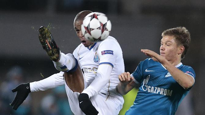 Porto's Fernando, left, and Zenit's Tomas Hubocan battle for the ball during the Champions League group G soccer match between Zenit and Porto at Petrovsky stadium in St.Petersburg, Russia, on Wednesday, Nov. 6, 2013