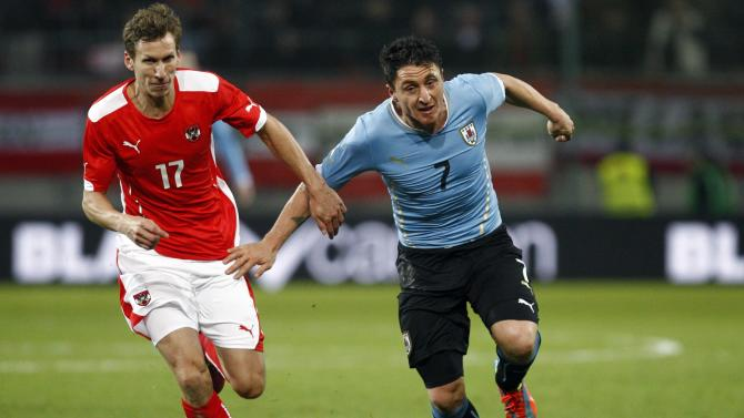 Austria's Klein and Uruguay's Jimenez fight for the ball during their international friendly soccer match in Klagenfurt