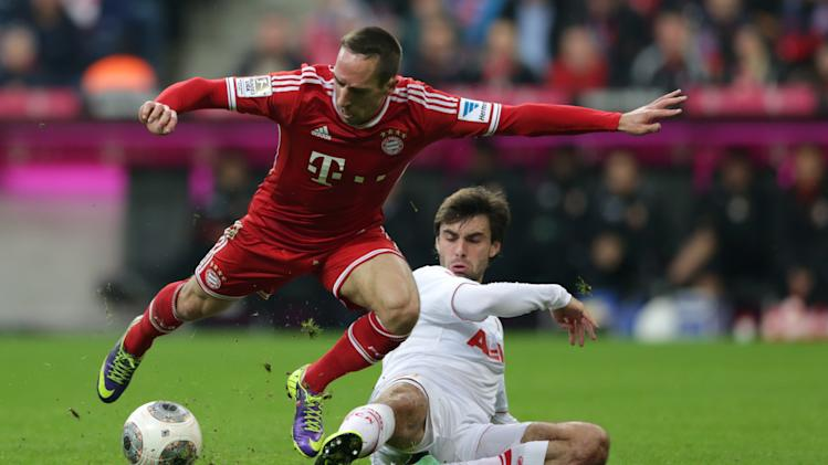 Bayern's Franck Ribery of France, left, and Augsburg's Jan Moravek of Czech Republic challenge for the ball during the German first division Bundesliga soccer match between FC Bayern Munich and FC Augsburg, in Munich, southern Germany, Saturday, Nov. 9 2013