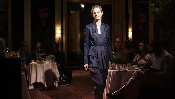 In this photo provided by The Row, shows The Row's Spring 2013 collection is modeled during Fashion Week in New York, Monday, Sept. 10, 2012. (AP Photo/The Row)