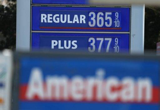"Gas prices below $4.00 per gallon are displayed at a gas station on July 12, 2012 in San Francisco, California. Oil prices fell amid worries that Washington will not act in time to stop the United States from going over the ""fiscal cliff"" by an end-of-year deadline."