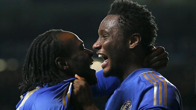 Chelsea's Victor Moses (L) celebrates with team mate John Obi Mikel after scoring a goal during their Champions League Group E match against Shakhtar Donetsk at Stamford Bridge (Reuters)