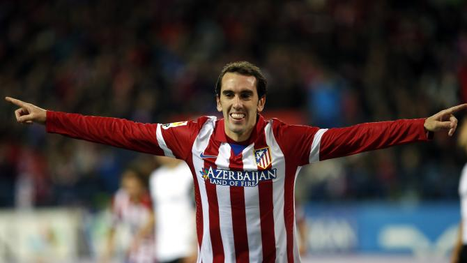 Atletico Madrid's Godin celebrates his goal during their Spanish King's Cup soccer match against Valencia in Madrid