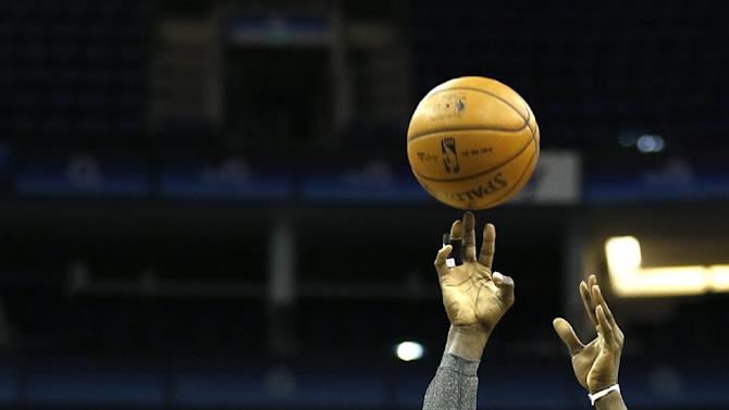 Brooklyn Nets player Kevin Garnett controls the ball during a training session at the O2 Arena in London, Wednesday, Jan. 15, 2014. The Atlanta Hawks will play the Brooklyn Nets in an NBA match at the O2 Arena on Thursday