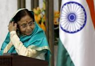 "India's President Pratibha Patil pictured during a joint press conference with Syrian counterpart Bashar al-Assad (not seen) at Al-Shaab palace in Damascus on November 2010. India's outgoing president has defended herself against media criticism that she went on a ""mercy overdrive"" during her term by granting clemency to nearly three dozen convicts on death row"