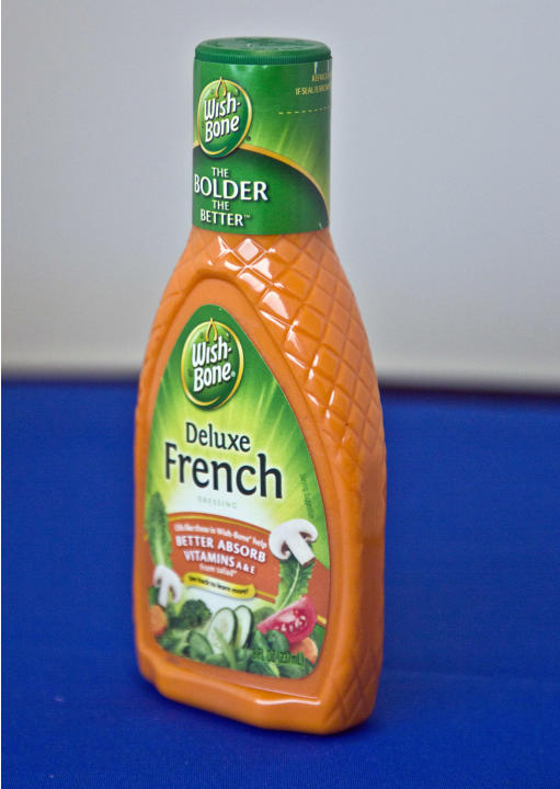 This Wednesday, March 4, 2015 photo shows a container of Wish-Bone's Deluxe French salad dressing, in New York. The product lists 4 grams (about 1 teaspoon) of sugar per serving (2 tablespoons). The W