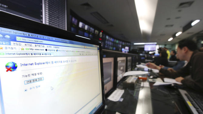 A disconnected computer monitor is seen at a newsroom of Korean Broadcasting System (KBS) at its headquarter in Seoul, South Korea, Wednesday, March 20, 2013. Computers networks at two major South Korean banks and three top TV broadcasters went into shutdown mode en masse Wednesday, paralyzing bank machines across the country and prompting speculation of a cyberattack by North Korea. (AP Photo/Kim Ju-sung, Yonhap) KOREA OUT