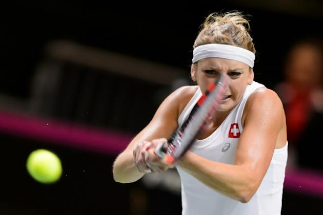 Swiss Timea Bacsinszky returns a shot during the Tennis Fed Cup semi-final between Switzerland and Czech Republic on April 17, 2016 in Lucerne, Switzerland