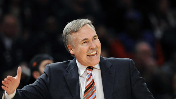 FILE - In this Feb. 4, 2012, file photo, then-New York Knicks coach Mike D'Antoni reacts during the third quarter of an NBA basketball game against the New Jersey Nets at Madison Square Garden in New York. D'Antoni's agent says the Los Angeles Lakers have signed the former coach of the Suns and Knicks to a four-year contract to replace Mike Brown in a deal late Sunday, Nov. 11, 2012, two days after the Lakers fired Brown five games into the season.(AP Photo/Bill Kostroun, File)