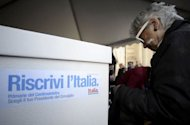 A Democratic Party supporter casts her ballot at a party polling station during the PD primary election in Rome. The centre-left in recession-hit Italy voted Sunday to choose the Democratic Party candidate who will run for prime minister in a general election next year that it is widely expected to win.