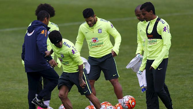 Brazil's players Alves, Hulk and Gustavo practice during a team training session at Santiago
