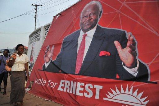 A woman walks past a poster of Sierra Leone's President Ernest Bai Koroma on November 14 in Freetown, ahead of general elections in Sierra Leone. Koroma was re-elected Friday after sweeping presidential polls with 58.7 percent of the vote, with his rival Julius Maada Bio garnering 37.4 percent, the electoral body said.