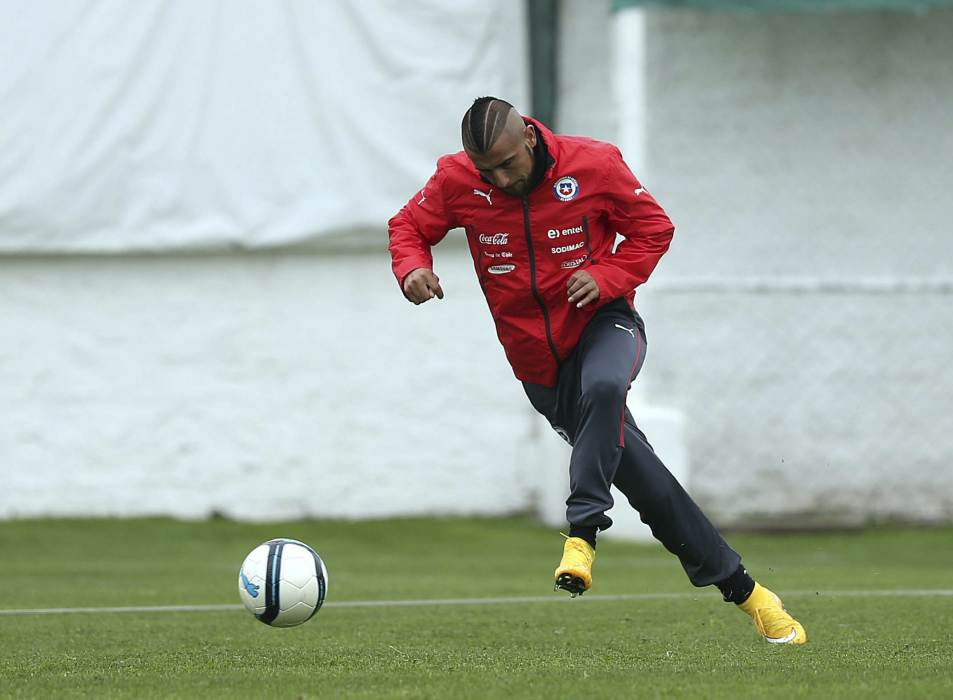 Chile's Arturo Vidal kicks a ball during a training session in Santiago