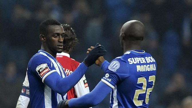 FC Porto's winning goal scorer Jackson Martinez, left, from Colombia is congratulated by fellow team member Eliaquim Mangala, from France, during a Portuguese League soccer match with Sporting Braga at the Dragao Stadium in Porto, Portugal, Saturday, Dec. 7, 2013. Jackson scored twice in Porto's 2-0 victory