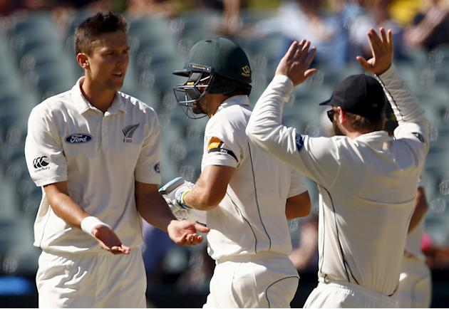 New Zealand's Trent Boult celebrates with team mates after dismissing Australia's Joe Burns LBW for 11 runs during the third day of the third cricket test match at the Adelaide Oval, in South