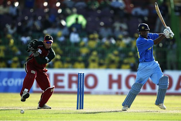 Mohammad Kaif of India on his way to a century watched by Andy Flower of Zimbabwe