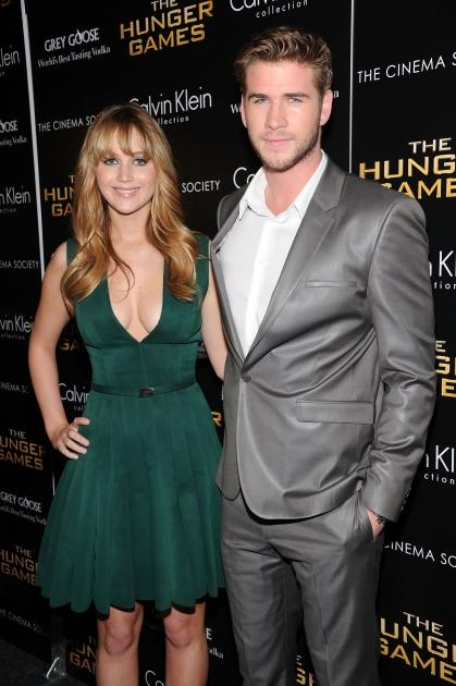 Jennifer Lawrence and Liam Hemsworth are seen at the Cinema Society & Calvin Klein Collection screening of 'The Hunger Games' in New York City on March 20, 2012 -- Getty Images