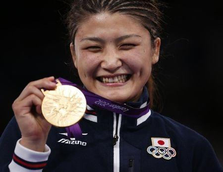 Japan's Kaori Icho poses with her gold medal at the podium of the Women's 63Kg Greco-Roman wrestling at the ExCel venue during the London 2012 Olympic Games