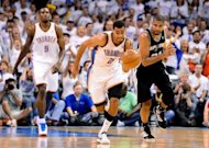 Oklahoma City Thunder's Thabo Sefolosha takes the ball down the court during game six of the NBA Western Conference finals on June 6. The Thunder won their fourth straight game to reach the NBA finals with a 107-99 victory over the Spurs