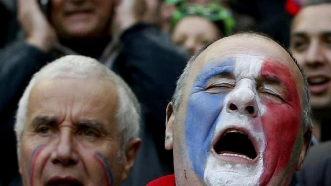 French supporters react during the Six Nations rugby union match between Ireland and France at the Stade de France in Saint-Denis, near Paris