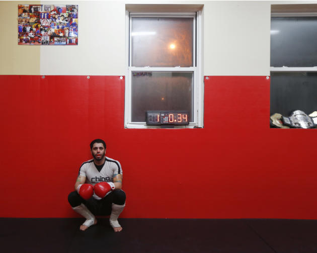 In this Wednesday, March 25, 2015 photo, mixed martial arts fighter Marcelo Miranda takes a break from sparring at Brian Beury Jiu Jitsu in Colonie, N.Y. Some MMA fighters training at Brian Beury Jiu
